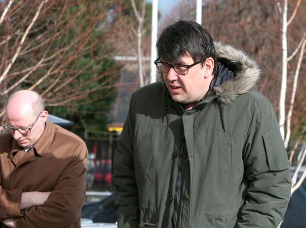 Writers of Father Ted, Graham Linehan, right, and Arthur Matthews arrive at the Church of the Guardian Angels in Blackrock for the funeral of Frank Kelly