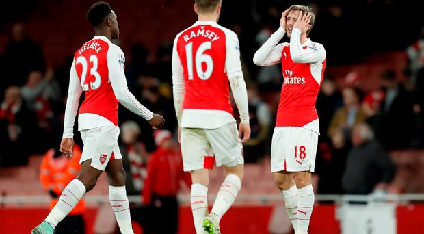 Arsenal's Danny Welbeck, Aaron Ramsey and Nacho Monreal look dejected after the game Action Images via Reuters / John Sibley