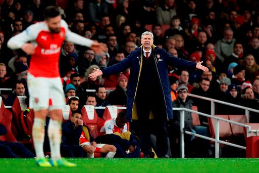 Arsene Wenger Manager of Arsenal gestures during the Barclays Premier League match between Arsenal and Swansea City at the Emirates Stadium