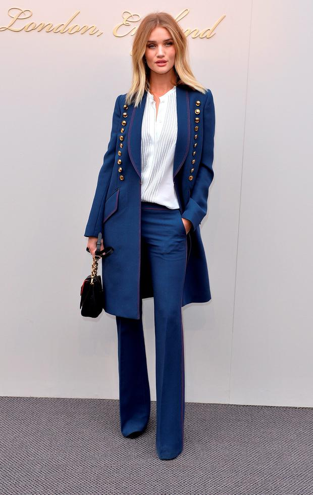 Sensational: Rosie Huntington-Whiteley attends the Burberry show.