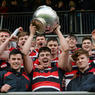 Wesley College captain Adam Curry lifts the Vinnie Murray Cup after the game (SPORTSFILE)
