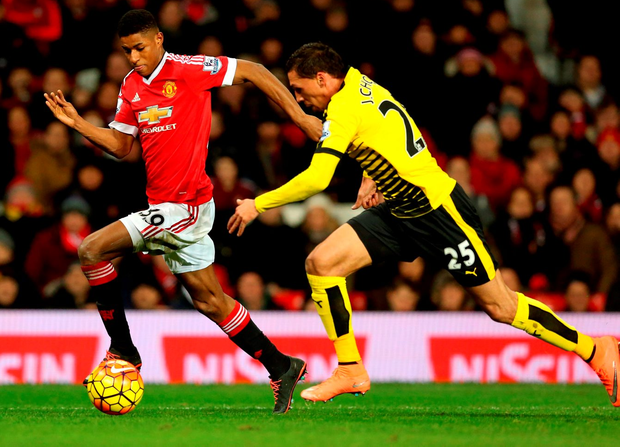 Manchester United's Marcus Rashford (left) battles for control of the ball with Watford's Jose Holebas Photo: Martin Rickett/PA Wire