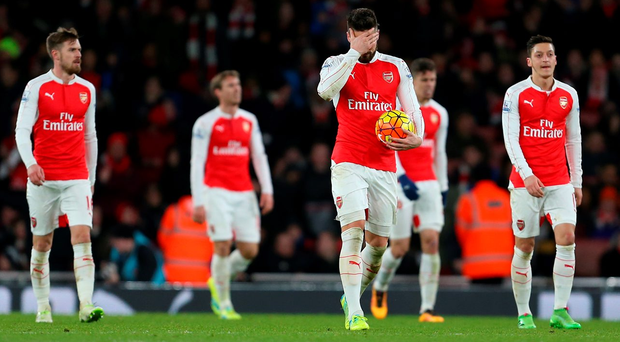 LONDON, ENGLAND - MARCH 02 : A dejected Olivier Giroud of Arsenal walks back with his team after Swansea City scored to take the lead Photo: Catherine Ivill - AMA/Getty Images