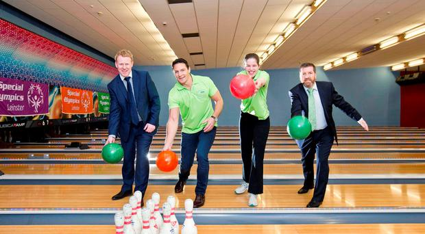 CEO of Gala Retail, Gary Desmond; Former Rugby International and Special Olympics board member, David Wallace and Special Olympics bowling athlete Deirdre Nevin, from Dunshaughlin, Co. Meath with CEO of Special Olympics Ireland Matt English at yesterday's Special Olympics event in Drogheda (Marc O'Sullivan)