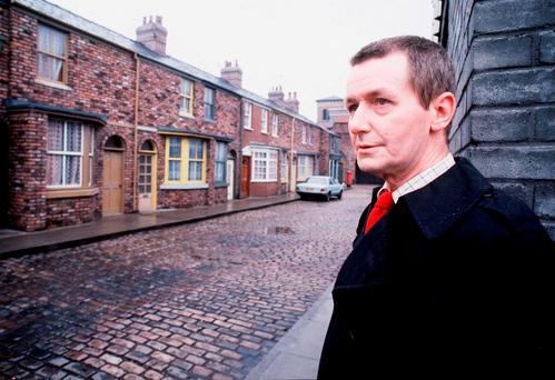 Series creator Tony Warren on the cobbled set of 'Coronation Street' in 1985. Photo: Granada TV/PA