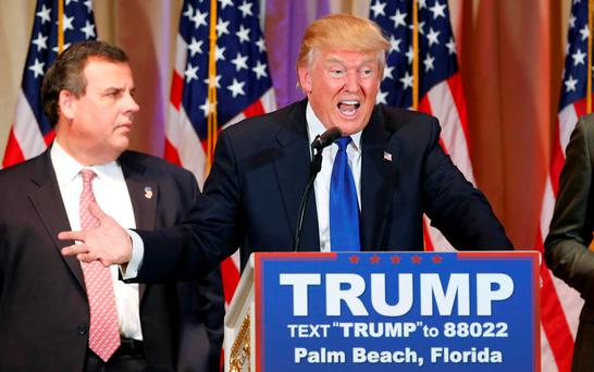 Donald Trump, with former rival candidate Governor Chris Christie (L) at his side, speaks about the results of Super Tuesday in Palm Beach, Florida Photo: REUTERS/Scott Audette