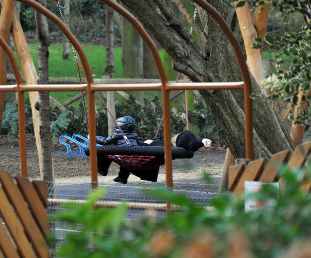 Adele and son Angelo (3) hit the swings in Merrion Park. Photo: John Dardis.