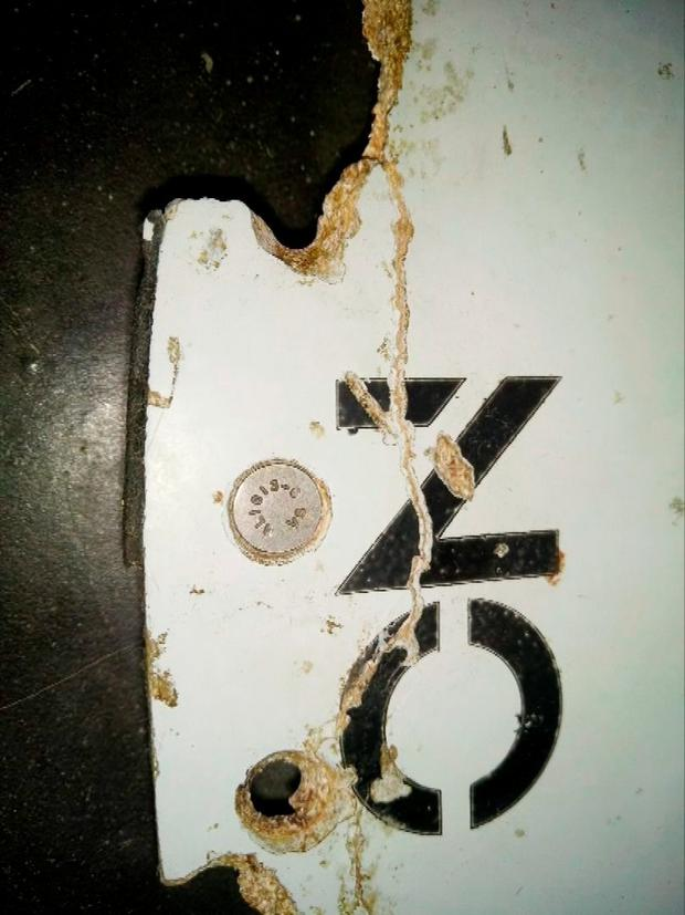 A photograph of debris thought to be from the missing Malaysian Airlines MH370 plane is seen in this still image taken from video shot March 3, 2016