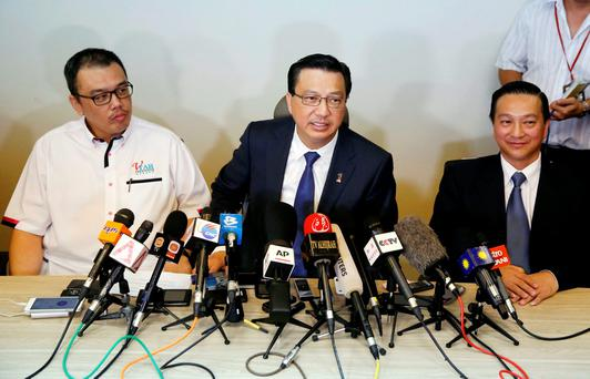 Malaysia's transport minister Liow Tiong Lai(C) speaks at a news conference about debris found on a beach in Mozambique that may be from missing Malaysia Airlines flight MH370, in Kuala Lumpur, Malaysia, March 3, 2016