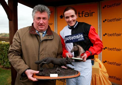 Paul Nicholls and Victoria Pendleton with the Dick Woodhouse Trophy after winning the Betfair Switching Saddles Hunter Chase at Wincanton Racecourse