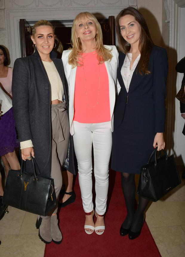 Georgia (far left) and Alannah McGurk with their pose with Miriam O'Callaghan