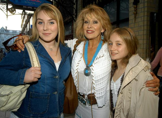 2005: Twink with daughters Naomi and Chloe Agnew.