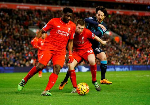 Manchester City's David Silva in action with Liverpool's Jon Flanagan and Kolo Toure