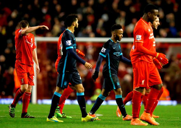 Manchester City's Raheem Sterling (centre right) walks off the pitch dejected at half time during the Barclays Premier League match at Anfield, Liverpool
