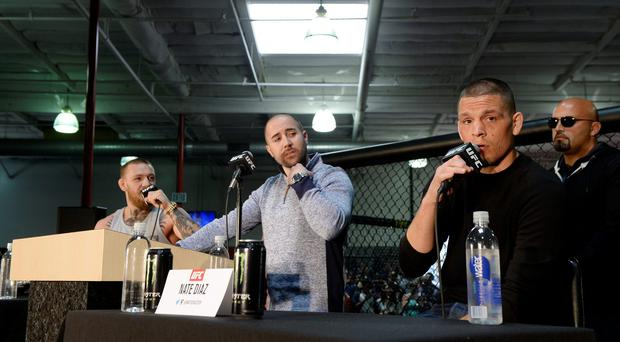 UFC featherweight champion Conor McGregor (L) and lightweight contender Nate Diaz (R) participate in a news conference