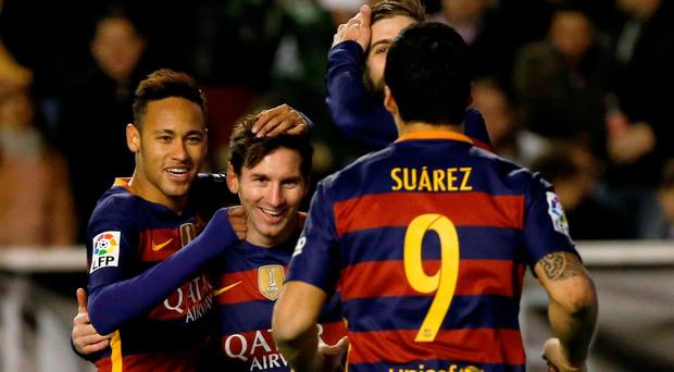 Lionel Messi celebrates with team mates Luis Suarez and Neymar after scoring his second goal. REUTERS/Sergio Perez