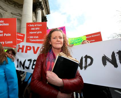 Fiona Kirby, of Kilbeggan, Co Westmeath, pictured with supporters outside the Four Courts after her High Court action was adjourned. Photo: Collins Courts