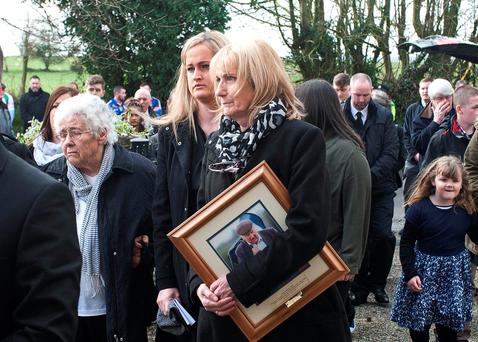Peter Keogh's sister Kathleen, grandaughter Lisa and daughter Josie at his funeral in Talbotstown, Co Wicklow. Photo: Garry O'Neill