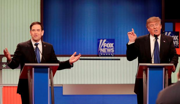 Marco Rubio (L) and rival candidate Donald Trump (R) speak simultaneously during the debate