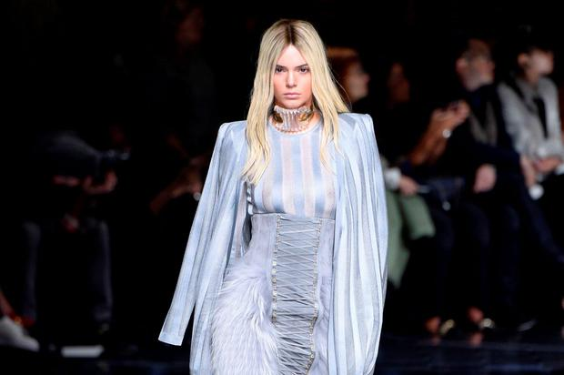 US model Kendall Jenner presents a creation for Balmain during the 2016-2017 fall/winter ready-to-wear collection fashion show