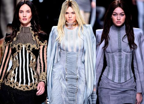 (L to R) Rosie Huntington Whiteley, Kendall Jenner and Gigi Hadid at Balmain during Paris Fashion Week