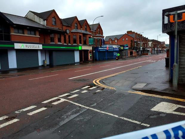 Police seal off a large area after a device exploded under a car in east Belfast, leaving a man injured. Photo: Lesley-Anne McKeown/PA Wire