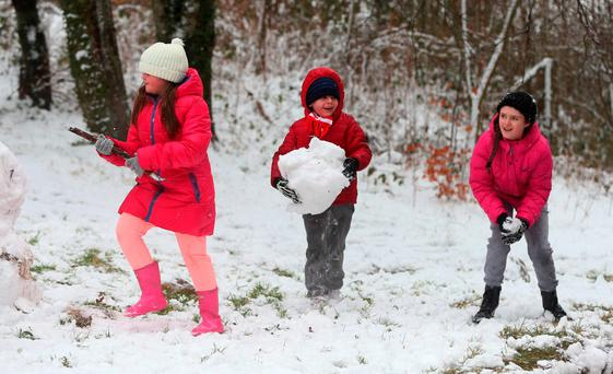 Children build a snowman in the Killakee area of the Dublin mountains. Photo: Niall Carson/PA Wire