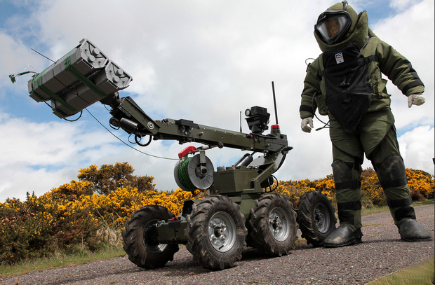 A bomb disposal operator with a HOBO robot - a sophisticated bomb disposal robot. Photo: Irish Defence Forces