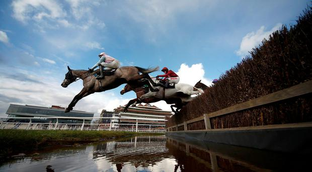 Horses clear the water jump in The Berry Bros & Rudd Handicap Chase at Newbury yesterday Photo: Getty