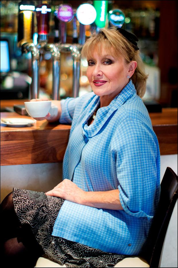 Adèle King (Twink) enjoys a coffee at the bar. Picture: David Conachy