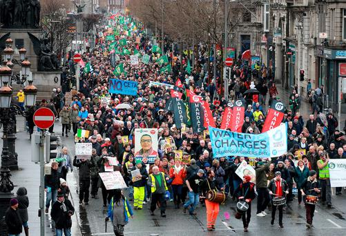 Anti-water charges protesters make their way down Dublin's O'Connell St in February. Photo: Frank McGrath