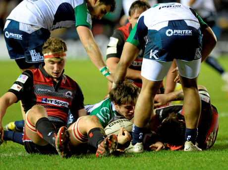 AJ MacGinty squeezes his way over for a Connacht try against Edinburgh Photo: Sportsfile