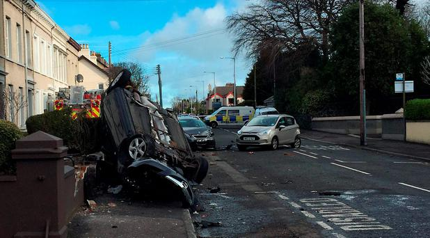 A fire engine that was stolen from a station and driven into nearby cars and houses in Glenarm Road, Larne, Co Antrim. David Young/PA Wire