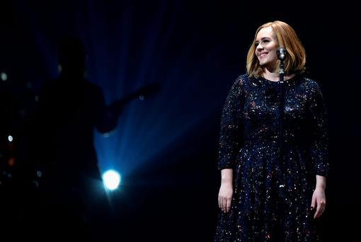 Adele performs on stage