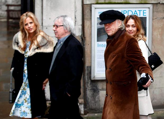 Musician Bob Geldof (2ndR) and his wife Jeanne Marine (R) arrive with musician Bill Wyman and his wife Suzanne Accosta at St Bride's church for a service to celebrate the wedding between media Mogul Rupert Murdoch and former supermodel Jerry Hall