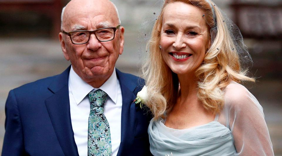 Media Mogul Rupert Murdoch and former supermodel Jerry Hall pose for a photograph outside St Bride's church following a service to celebrate their wedding