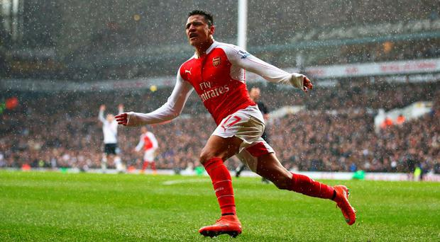 Alexis Sanchez celebrates scoring his team's second goal