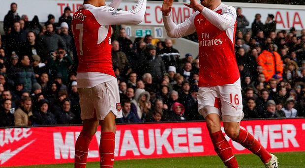 Alexis Sanchez celebrates with Aaron Ramsey