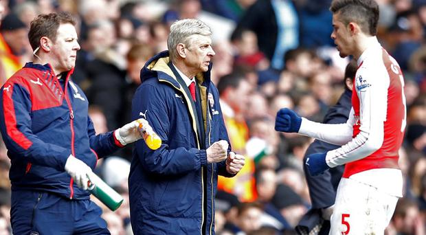 Arsenal manager Arsene Wenger and Gabriel Paulista celebrate after Aaron Ramsey scores their first goal