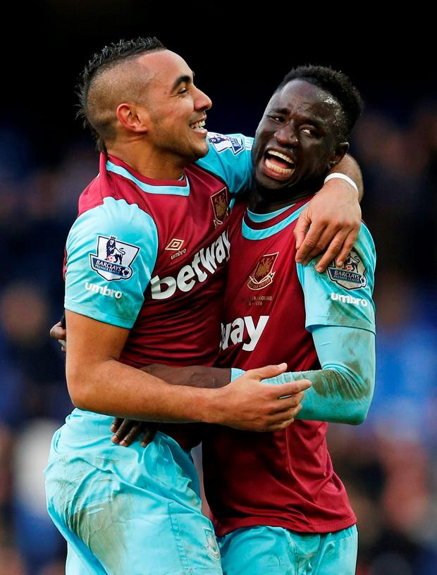 West Ham's Dimitri Payet and Cheikhou Kouyate celebrate after the match