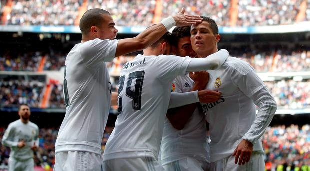 Real Madrid's Cristiano Ronaldo celebrates a goal against Celta Vigo with teammates