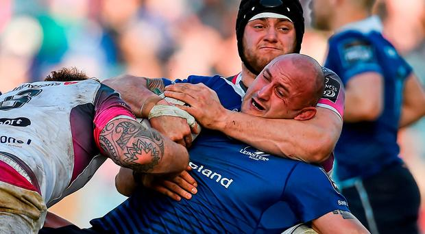 Hayden Triggs, Leinster, is tackled by Dan Baker, left, and James King, Ospreys