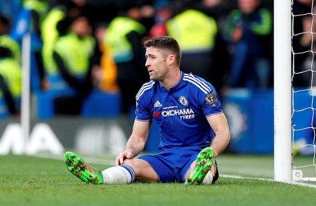 Chelsea's Gary Cahill sits dejected after Stoke City score during the Barclays Premier League match at Stamford Bridge