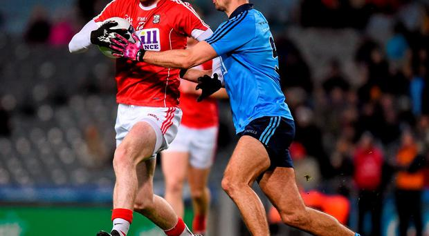 Luke Connolly, Cork, in action against James McCarthy, Dublin