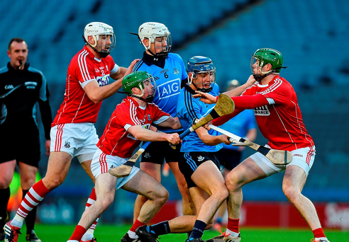 Eoghan O'Donnell and Chris Crummy, Dublin, in action against Cormac Murphy, right, Patrick Cronin and Daniel Kearney, Cork