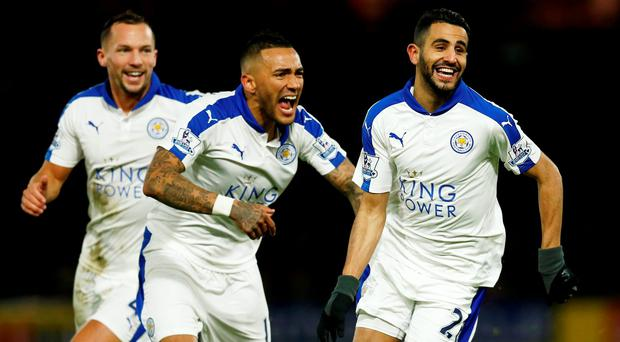 Riyad Mahrez celebrates with team mates after scoring the first goal for Leicester