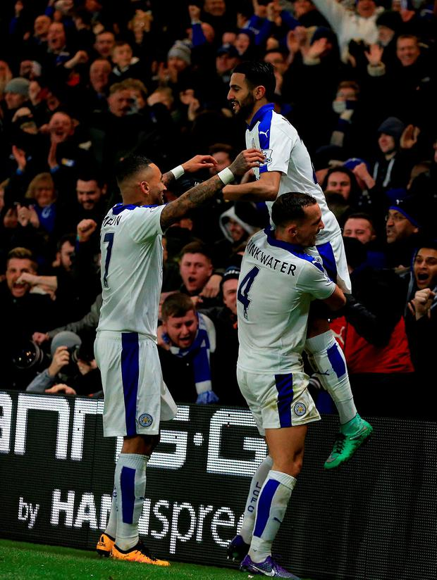 Leicester City's Riyad Mahrez (right) celebrates scoring his side's first goal