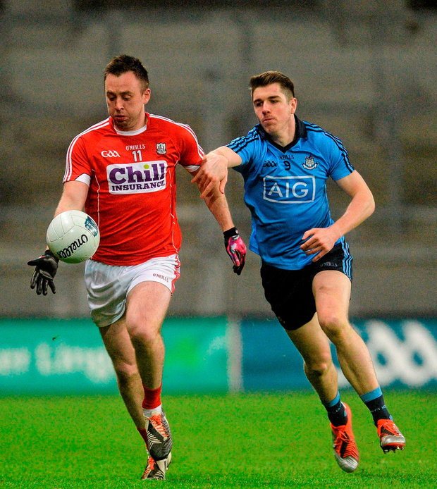 Paul Kerrigan, Cork, in action against Emmet Ó Conghaile, Dublin