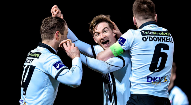 Ronan Finn, Dundalk, is congratulated by team-mate Dane Massey and Stephen O'Donnell after he scored against Bray Wanderers