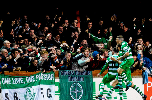 Brandon Miele, Shamrock Rovers, celebrates scoring his sides first goal with teammates and supporters